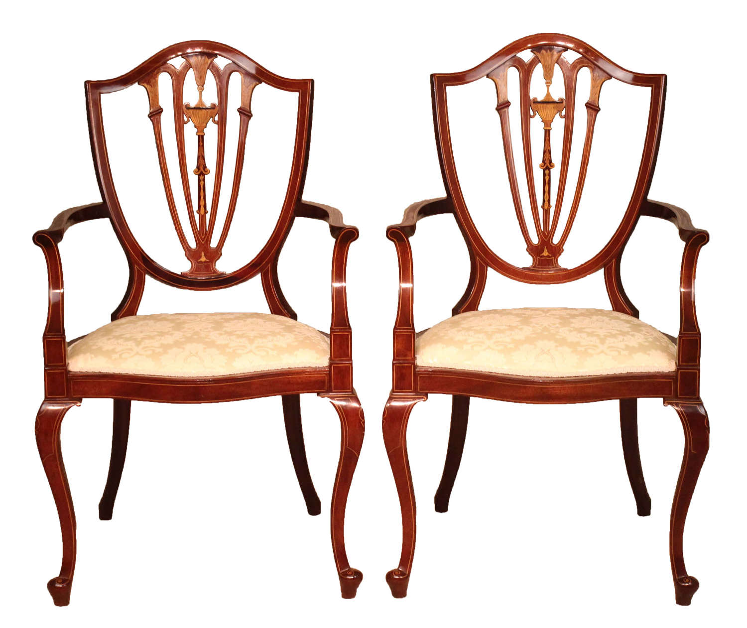 A Pair of Late Victorian Mahogany inlaid shield back armchairs