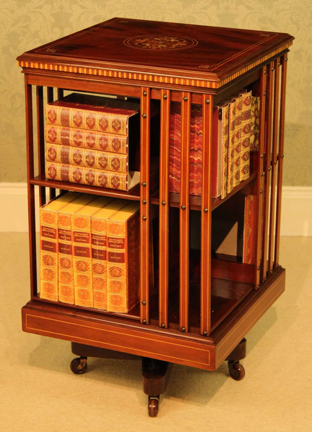 A Late Victorian Mahogany inlaid revolving bookcase by Maple & Co