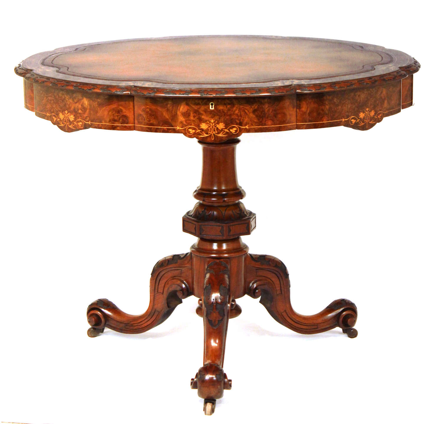 A Victorian Inlaid and Carved Walnut Drum Table