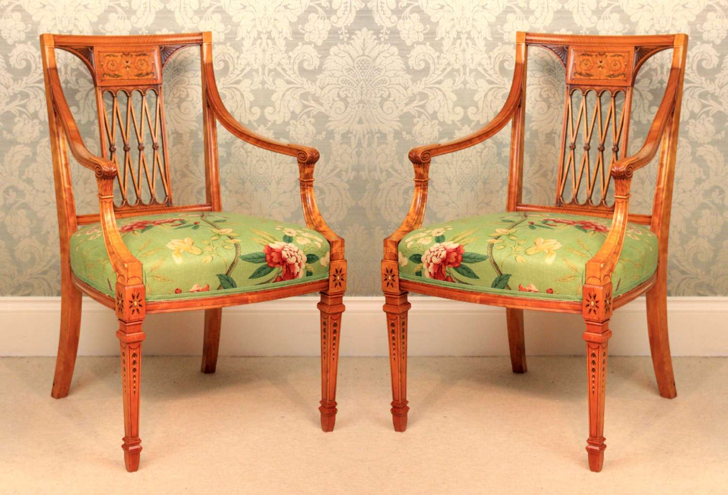 An Elegant Pair of Painted and Carved Satinwood Side Chairs