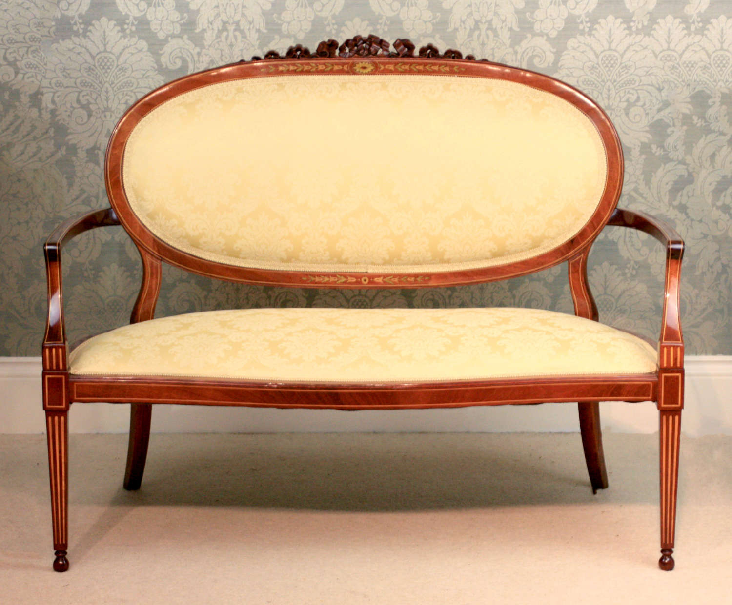 A Fine Carved Late Victorian Mahogany Inlaid Upholstered Settee