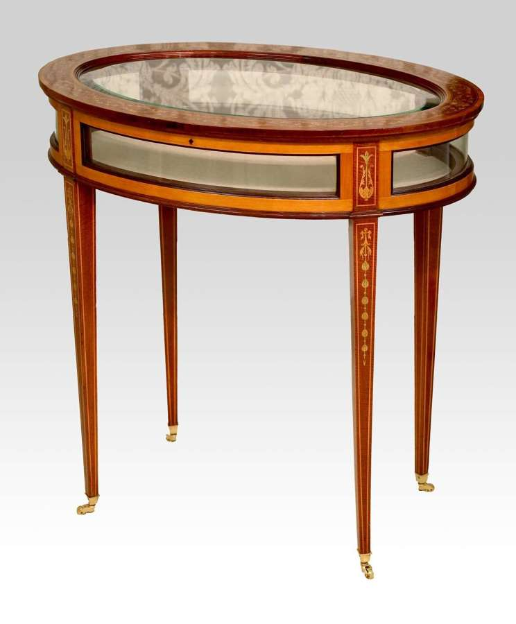 An Edwards & Roberts Victorian Mahogany Inlaid Oval Bijouterie Table